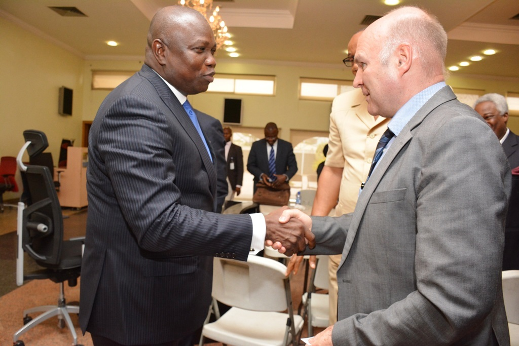 Lagos State Governor, Mr. Akinwunmi Ambode (left) in a warm handshake with Managing Director, Julius Berger, Mr. Lubasch Detfev (right) during his meeting with group of Local, International investors and Banks at Lagos House, Ikeja, on Wednesday, July 08, 2015.