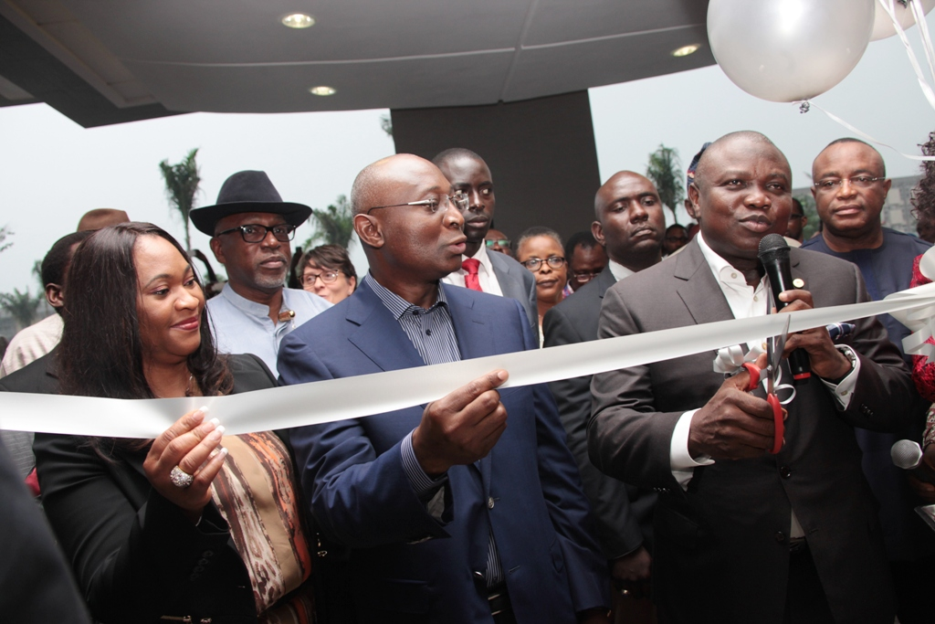 Lagos State Governor, Mr. Akinwunmi Ambode (right) cutting the tape to commission The George Hotel at Ikoyi, the Chairman of the Hotel, Mr. Tien George(middle) with his wife, Dorcas (left) during the event on Friday, July 10, 2015.