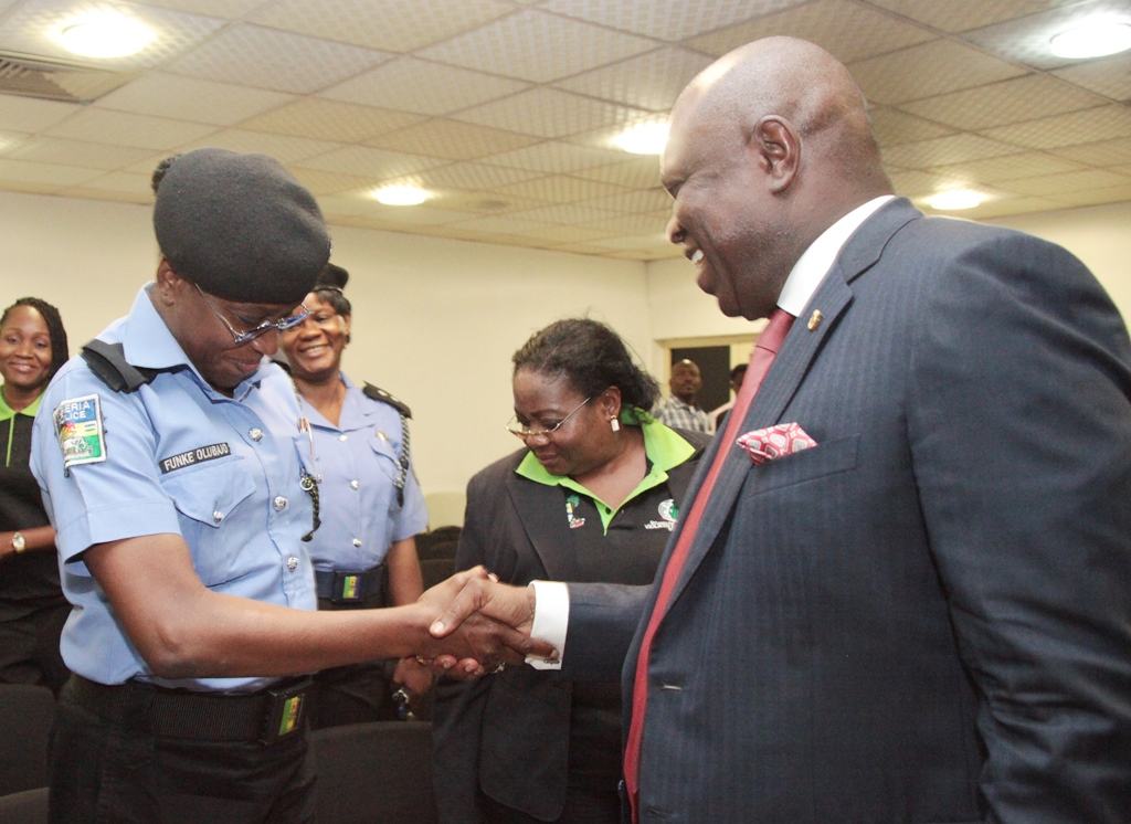 Lagos State Governor, Mr. Akinwunmi Ambode (right) in a warm handshake with the Divisional Police Officer, Iso-koko, Agege, Mrs. Funke Olubajo (left) during his meeting with Lagos State Domestic and Sexual Violence Response Team at Lagos House, Ikeja, on Tuesday, July 21, 2015.