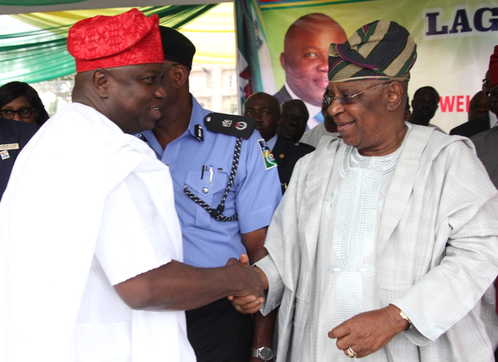 Lagos State Governor, Mr. Akinwunmi Ambode (left), exchanging  pleasantries with the State Chairman, All Progressives Congress (APC), Otunba Henry Ajomale (right) during the commissioning of 20 Mobile Care Unit and 26 Number Transport Ambulances at Lagos House, Ikeja, on Monday, August 31, 2015.