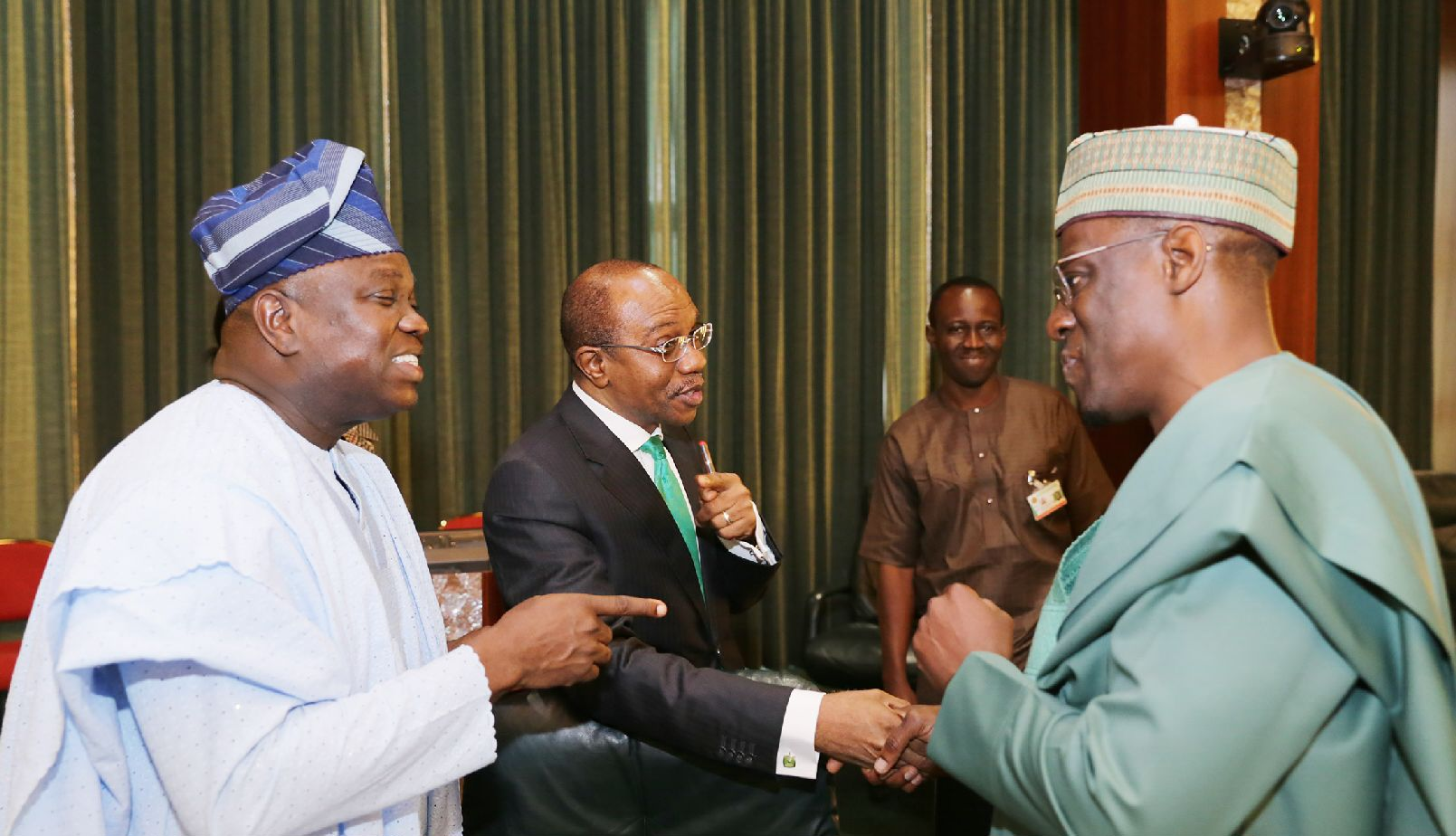 L-R: Lagos State Governor, Mr. Akinwunmi Ambode, Governor, Central Bank of Nigeria, Mr. Godwin Emefiele  and Governor of Kwara State, Alhaji Abdulfatah Ahmed during the NEC meeting at the State House, Abuja on Thursday, September 17, 2015.