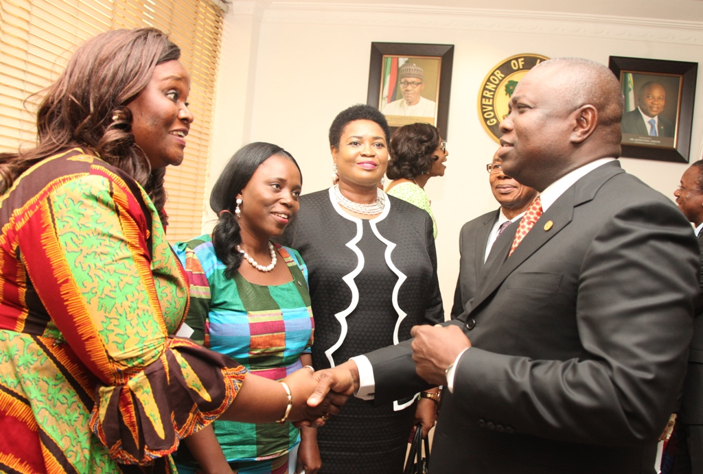 Lagos State Governor, Mr. Akinwunmi Ambode (right) in a warm handshake with a member of Hubert Humphrey Fellowship Alumni Association, Nigeria, Mrs. Uchechi Onukogu while other members of the Association; Mrs. Okonkwo Chinyere and Deputy Chief Registrar (Legal), High Court of Lagos State, Mrs. Eniola Fabamwo watch with admiration during a courtesy visit to the Governor by members of Hubert Humphrey Association, at the Lagos House, Ikeja, on Friday, September 18, 2015.