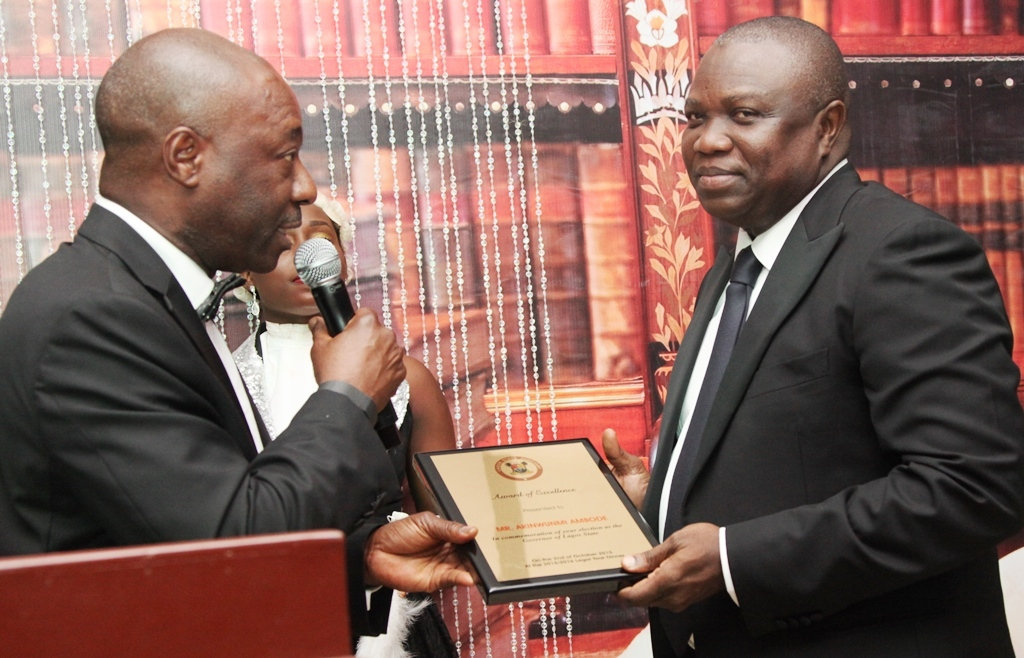 Lagos State Governor, Mr. Akinwunmi Ambode (right), receiving an award of Excellence from Hon. Justice Akeem Olatunde Oshodi, during the 2015/2016 Legal Year Dinner, at the Law School, Victoria Island, Lagos, on Friday, October 2, 2015