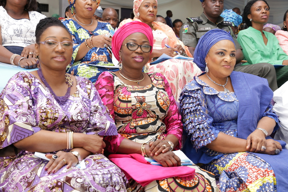 "Wife of the Governor of Lagos State, Mrs. Bolanle Ambode (m); wife of the Governor of Oyo State & Founder of Access to Basic Medical Care Foundation, Mrs. Florence Ajimobi (right); and wife of the Minister of Solid Minerals Development, Erelu Bisi Fayemi, during the 3rd annual Access to Basic Medical Care Foundation's medical symposium with the theme: ""The Role of HPV Testing in Cervical Cancer Screening in Nigeria"", at the Mauve 21 event centre, Ibadan, Oyo State"