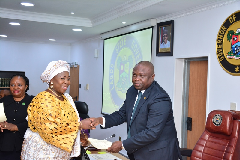 Lagos State Governor, Mr. Akinwunmi Ambode (right), congratulating Mrs. Amudat Elizabeth Adekanye (left) after being sworn-in as PS/Tutor General, Education District V, at the EXCO Chamber, Lagos House, Ikeja, on Wednesday, October 12, 2016.