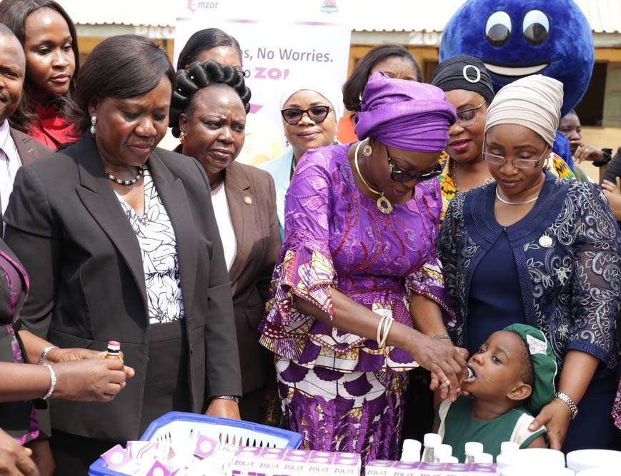 Wife of Lagos State Governor, Mrs. Bolanle Ambode (2nd right), administering de-worming syrup on one of the pupils of Lagos State public primary schools, supported by Commissioner for Youth and Social Development, Pharm. (Mrs) Uzamat Akinbile-Yusuf (right) while the Acting HOS, Mrs. Folashade Adesoye (left); Special Adviser to the Governor on Arts & Culture, Hon. Adebimpe Akinsola (2nd left) and her counterpart for Housing, Mrs. Aramide Giwanson (3rd left), watch during the flag-off of Mass Deworming programme for pupils in Public Primary Schools, organized by  the Ministry of Youth and Social Development, at Maryland, Lagos, on Monday, 23 January, 2017.