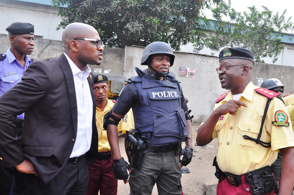 General Manager, Lagos State Traffic Management Authority, LASTMA, Mr. Olawale Musa; Chairman, Lagos State Task Force, SP Yinka Egbeyemi and LASTMA Traffic Officer, Mr. Akande Abiodun during a joint traffic enforcement at Agege and its environs on Friday, January 20, 2017.
