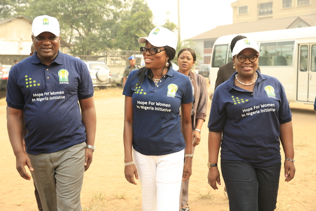Wife of Lagos State Governor and Founder, Hope for Women in Nigeria Initiative (HOFOWEM), Mrs. Bolanle Ambode (middle), flanked by Executive Chairman, Lagos State Universal Basic Education Board (SUBEB), Dr. Ganiyu Sopeyin (left) and member of HOFOWEM's Educational Team, Dr. (Mrs.) Yinka Ayandale (right) during the distribution of shoes and socks to pupils of Public Primary Schools in the State, at one of the distribution centres, the Central Primary School, Ikeja, on Monday, 20 February, 2017.