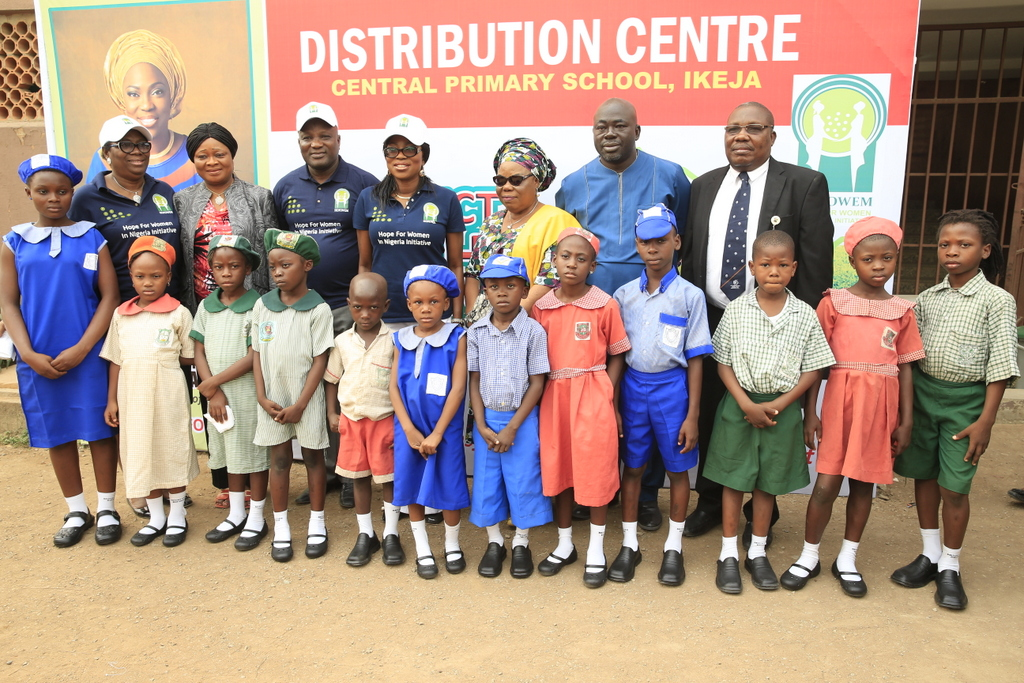 Wife of Lagos State Governor of and founder, Hope for Women in Nigeria Initiative (HOFOWEM), Mrs. Bolanle Ambode (middle); Executive Chairman, Lagos State Universal Basic Education Board (SUBEB), Dr. Ganiyu Sopeyin (3rd left); Secretary of LSUBEB, Mrs. Abosede Adelaja (left) and members of the board with some pupils who benefitted from the distribution of shoes and socks to pupils of Public Primary Schools in the State, at one of the distribution centres, the Central Primary School, Ikeja, on Monday, 20 February, 2017.