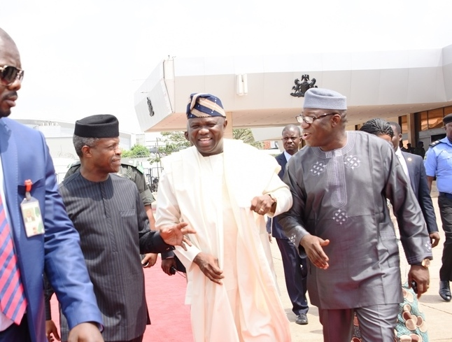 Lagos State Governor, Mr. Akinwunmi Ambode (middle); Acting President, Prof. Yemi Osinbajo (left) and Minister of Solid Minerals, Dr. Kayode Fayemi (right) during the arrival of the Acting President at the Presidential Wing of the Muritala Muhammed International Airport, Ikeja, Lagos, on Tuesday, March 7, 2017