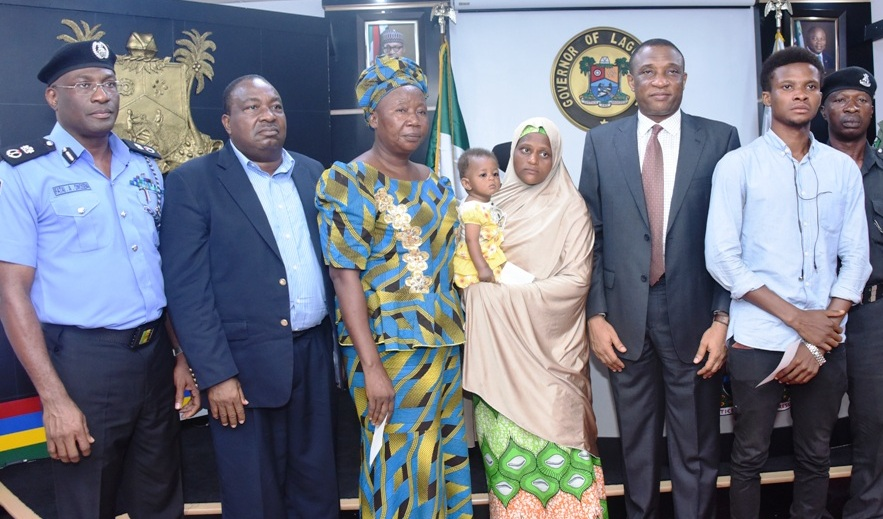 Commissioner of Police, Mr. Fatai Owoseni; Chairman, Lagos State Neigbourhood Safety Corps, Rtd. D.I.G Israel Ajao; widows of killed Policemen, Mrs. Temilade Godwin; Mariam Mamuda; Secretary to the State Government, Mr. Tunji Bello; Son of killed Policeman, Mr. Francis Emmanuel; CSP. Ejiofor Obiora during the presentation of cheques to the Families of the Killed Policemen by Governor Akinwunmi Ambode at the Lagos House, Ikeja, on Monday, May 15, 2017.