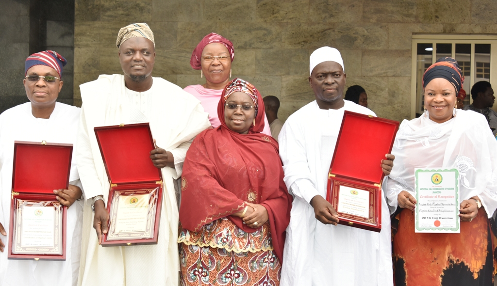 Representative of Lagos State Governor & Deputy Governor, Dr. (Mrs) Oluranti Adebule (middle); South West Commissioner, National Hajj Commission of Nigeria, Imam Fauad Adeyemi (2nd right); Special Adviser to the Governor on Housing, Mrs. Aramide Giwanson (right); Commissioner for Home Affairs, Dr. Abdul-Lateef Abdul-Hakeem (2nd left); CEO, Medview Airline Plc., Mr. Muneer Bankole (left) and Managing Director, Africana Home Restaurant Dubai, Mrs. Khadijat Ebon Bakare (behind) during the awards presentation to the Lagos State Government by the Hajj Commission at the Lagos House, Ikeja, on Friday, July 7, 2017.