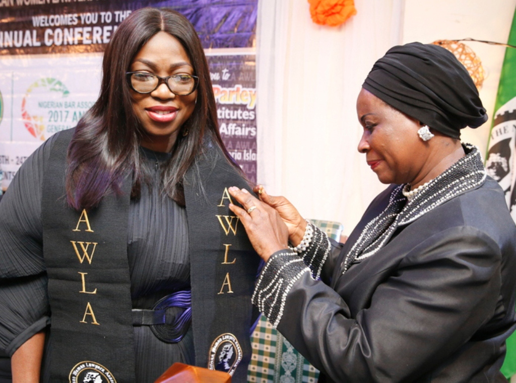 "Wife of Lagos State Governor, Mrs. Bolanle Ambode (left), being decorated as ""Matron and mother of the African child"", by the African Women Lawyers' Association - Nigeria, during the AWLA parley, as part of activities marking the Annual General Conference of Nigerian Bar Association (NBA), at Victoria Island, Lagos, recently"