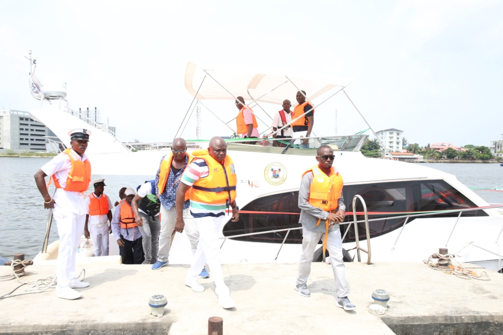 Lagos State Governor, Mr. Akinwunmi Ambode (middle), exiting from one of the new Executive Boats acquired by the State Government shortly after the commissioning at the Caverton Jetty, Victoria Island, Lagos, on Sunday, November 5, 2017.