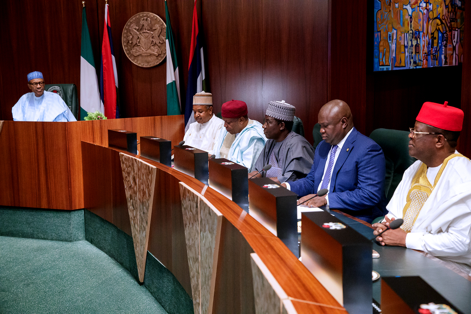 President Muhammadu Buhari (left); Lagos State Governor, Mr. Akinwunmi Ambode (2nd right); Governor David Umahi of Ebonyi State (right); Governor of Plateau State, Barr. Simon Lalong (3rd right); Governor Darius Ishaku of Taraba State (3rd left) and Governor Atiku Bagudu of Kebbi State (2nd left) during the inauguration of National Food Security Council by the President at the Council Chamber, Presidential Villa, Abuja, on Monday, March 26, 2018.
