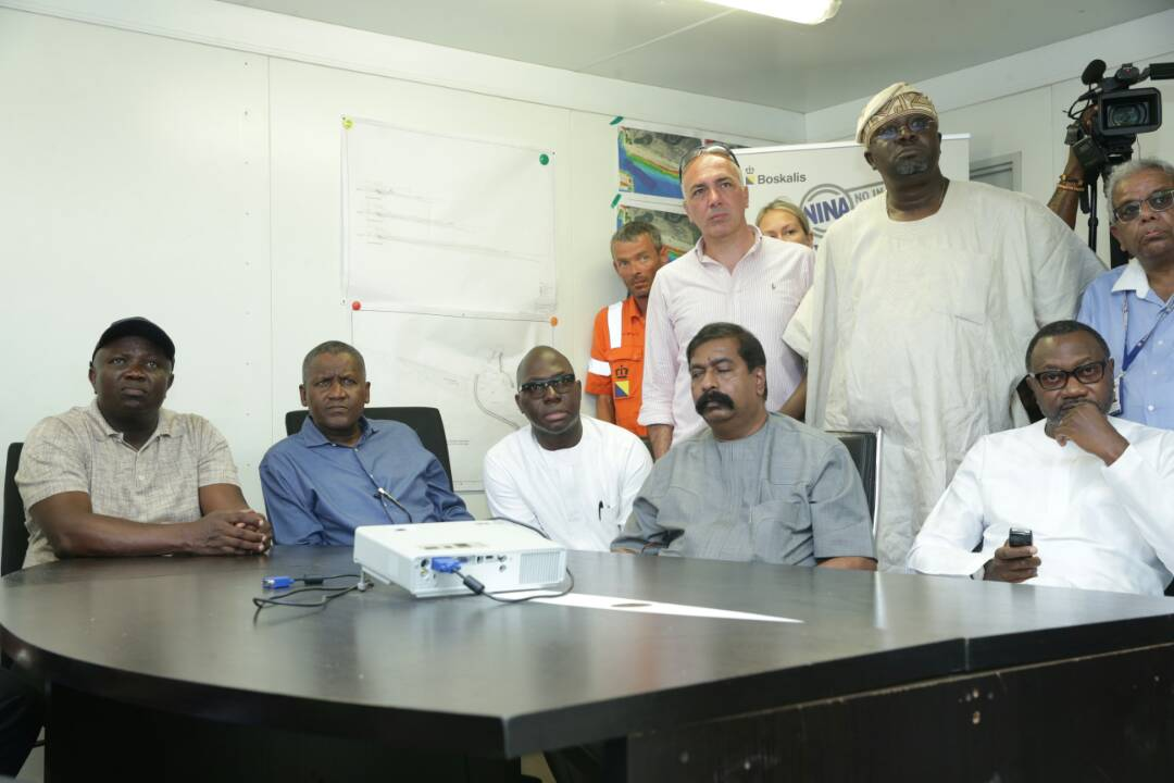 Lagos State Governor, Mr. Akinwunmi Ambode; President, Dangote Group, Alhaji Aliko Dangote; CEO, Enyo Retail & Supply Limited, Mr. Abayomi Awobokun; Executive Director, Dangote Group, Mr. Davkumar Edwin; Chairman, Forte Oil PLC, Mr. Femi Otedola and others during the Governor's inspection of the ongoing Sea Port Project at the Lekki Free Trade Zone, Ibeju-Lekki, on Sunday, May 20, 2018.