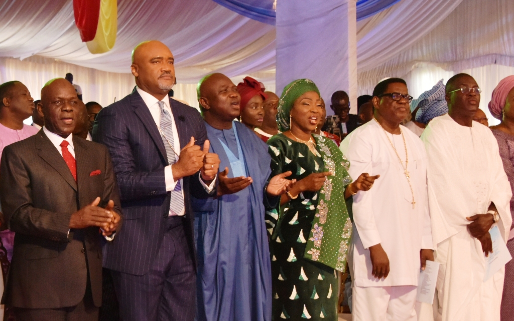 Lagos State Governor, Mr. Akinwunmi Ambode (3rd left), his wife, Bolanle (3rd right); Chairman, Christian Association of Nigeria (CAN) Lagos Chapter, Apostle Alexander Bamgbola (2nd right); former Deputy Governor of Lagos State, Otunba Femi Pedro (right); General Overseer, House on The Rock, Pastor Paul Adefarasin (2nd left) and Chairman, APC Lagos State, Alhaji Tunde Balogun (left) during the Thanksgiving Service to mark the 3rd Year Anniversary of Governor Akinwunmi Ambode's administration at Lagos House, Alausa, Ikeja, on Sunday, May 27, 2018.