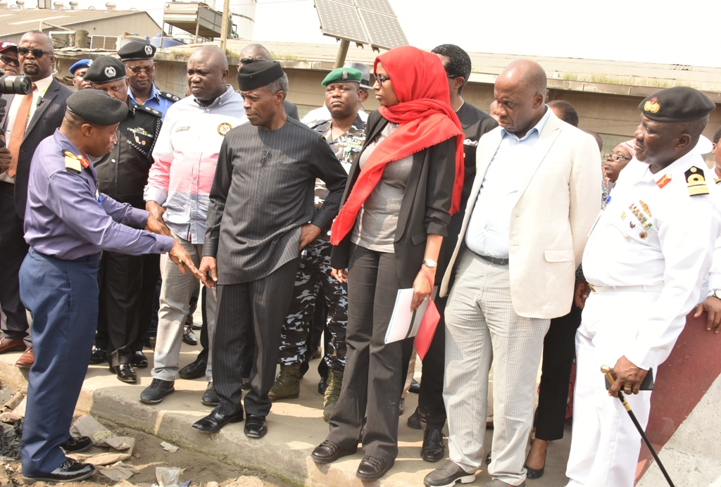Vice President, Prof. Yemi Osinbajo (3rd left); Lagos State Governor, Mr. Akinwunmi Ambode (2nd left); Commander, NNS Beecroft Apapa, Commodore Okon Edet (left); Managing Director, Nigerian Ports Authority (NPA), Hadiya Hadiza Bala Usman (3rd right); Minister of Transportation, Mr. Rotimi Amaechi (2nd right) and Flag Officer Commanding, Western Naval Command, Rear Admiral Sylvanus Abah (right) during an inspection on the state of Apapa shortly after a meeting with Maritime Unions and stakeholders, on Thursday, July 26, 2018.