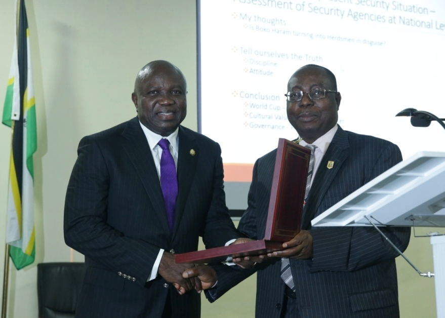 Lagos State Governor, Mr. Akinwunmi Ambode (left), being presented with a plaque by the Director of Institute for Security Studies, Mr. Matthew Seiyfa during the 2018 Executive Management Course of the Institute for Security Studies in Abuja, on Tuesday, July 24, 2018.