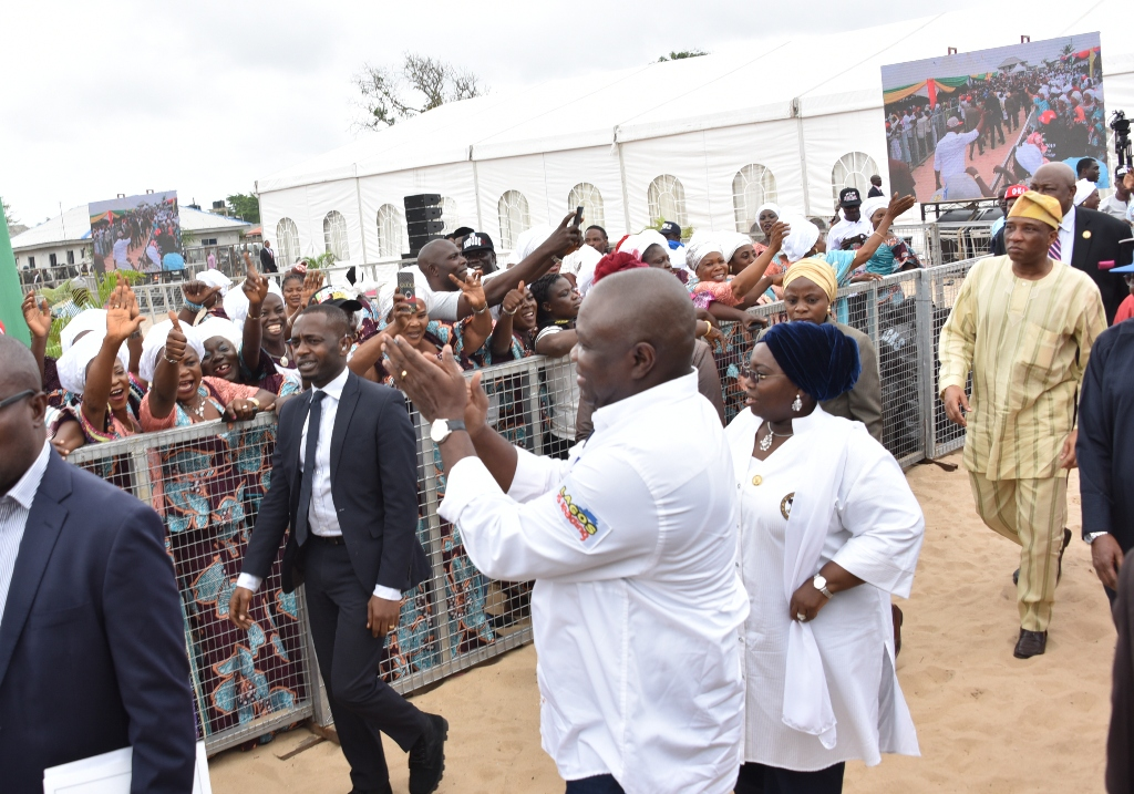 Lagos State Governor, Mr. Akinwunmi Ambode (left), acknowledging cheers from residents at the 3rd Quarter 2018 Town Hall meeting (12th in the Series), held at Community Primary School, Iberekodo, Ibeju-Lekki, on Wednesday, July 25, 2018. With him is the Deputy Governor, Dr. (Mrs) Oluranti Adebule (right).
