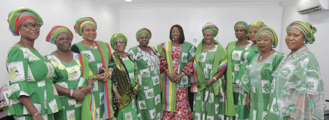 Wife of Lagos State Governor, Mrs. Bolanle Ambode (middle), with the President, National Council of Women's Societies (NCWS), Nigeria, Lagos State Branch, Alhaja Agoro Sikirat (5th right); Alhaja Memunat Ajao (5th left) and other members of the council during the investiture of the wife of the Governor as Patron of NCWS Lagos State, at the weekend, at Lagos House, Alausa, Ikeja.