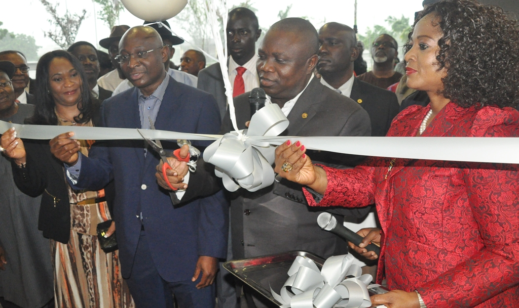 Lagos State Governor, Mr. Akinwunmi Ambode (2nd right) cutting the tape to commission The George Hotel at Ikoyi, the Chairman of the Hotel, Mr. Tien George(2nd left) with his wife, Dorcas (left) and Managing Partner, Mrs. Chizor Malize (right) during the commissioning of The George Hotel, Ikoyi on Friday, July 10, 2015.