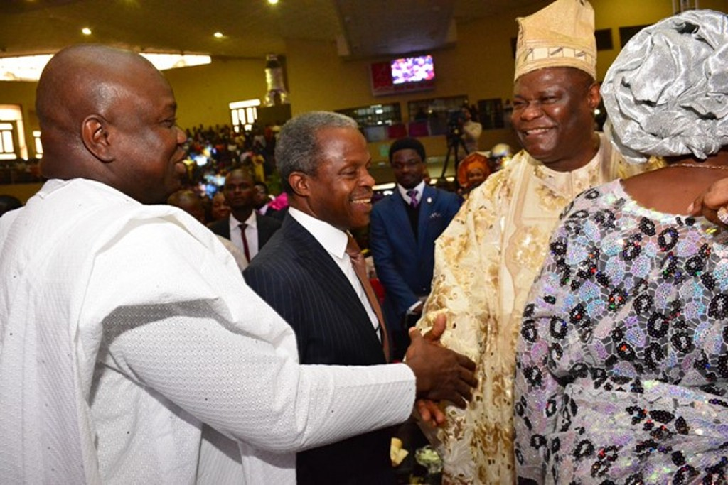 Lagos State Governor, Mr. Akinwunmi Ambode (left) in a warm handshake with the Celebrant & General Overseer, The Redeemed Evangekical Mission, TREM, Bishop Mike Okonkwo (right) while the Vice President, Prof. Yemi Osinbajo (middle) looks with admiration during the 70th Birthday Special Thanksgiving Service of Bishop Mike Okonkwo at the TREM Headquaters, Gbagada on Sunday, September 06, 2015.