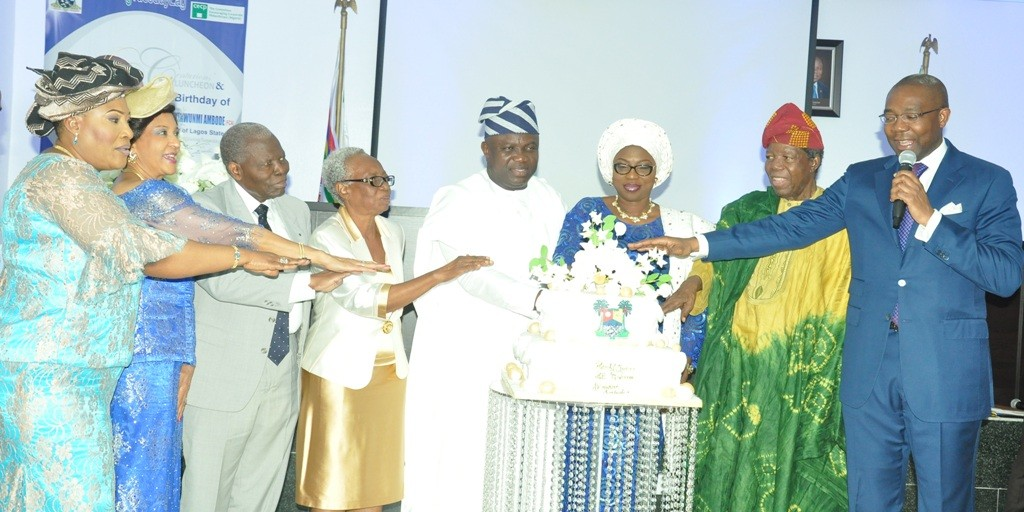R-L: Lagos State Governor, Mr. Akinwunmi Ambode (4th right), his Wife, Bolanle (3rdright); President, Nigerian Stock Exchange (NSE), Mr. Aigboje Aig-Imoukhuede; members of Committee Encouraging Corporate Philanthropy (CECP-Nigeria) - Dr. Michael Omolayole; Convener, Mrs. Tutu Adeleke; Dr. Christopher Kolade; Publisher, Guardian Newspapers, Maiden Alex Ibru and Chief (Mrs.) Kemi Nelson, jointly cutting the cake during a Special #GivingTuesday organized by the CECP-Nigeria to mark the Governor's 53rd birthday, at the Banquet Hall, Lagos House, Ikeja, on Tuesday, June14, 2016.