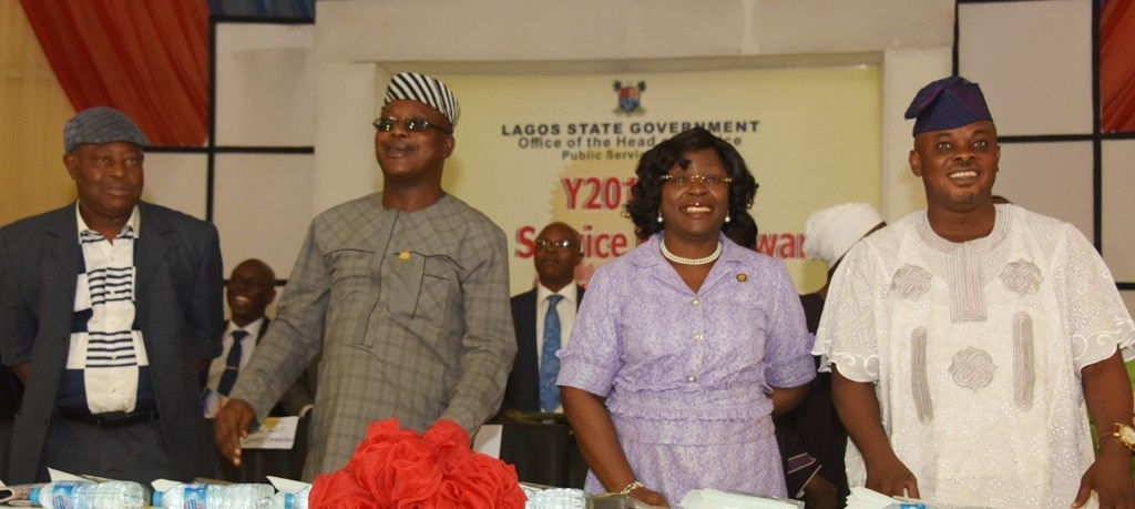 L-R: Chairman, Local Government Service Commission, Alhaji Babatunde Rotinwa; Representative of Lagos State Governor, Commissioner for Establishment & Training, Dr. Benson Akintola; Head of Service; Mrs. Olabowale Ademola and Chairman, House Committee on Establishment & Training, Hon. Adedayo Famakinwa during the Long Service Merit Award as part of activities marking the Y2016 Public Service Day with the theme Inclusiveness and Public Service Delivery, at the Adeyemi Bero Auditorium, Alausa, Ikeja on Thursday, June 16, 2016.