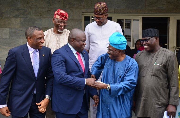 Lagos State Governor, Mr. Akinwunmi Ambode (2nd left); with Secretary to the State Government, Mr. Tunji Bello (left); Representative of Victoria Island/Ikoyi Residents Associations (VIIRA), Dr. Ishola Salami (2nd right); Sole Administrator, Ikoyi/Obalende LCDA, Mr. Goke Ona-Olawale (right); Commissioner for Tourism, Arts & Culture, Mr. Folorunsho Folarin-Coker (right behind) and another representative of VIIRA, Alhaji Abdul-Lateef Muse (left behind) during the inauguration of a Committee on Clean-up of Victoria Island/Ikoyi/Lekki Areas at the Lagos House, Ikeja, on Tuesday, August 30, 2016.