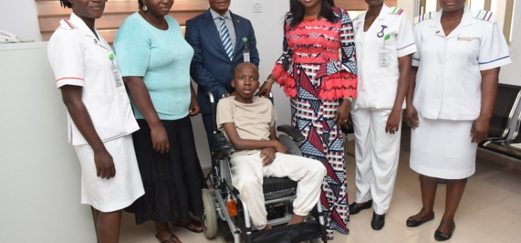 Pictures: Wife Of Lagos State Governor, Mrs. Bolanle Ambode Presents Motorized Wheelchair To Physically Challenged Oluwaseun Ikubisehin